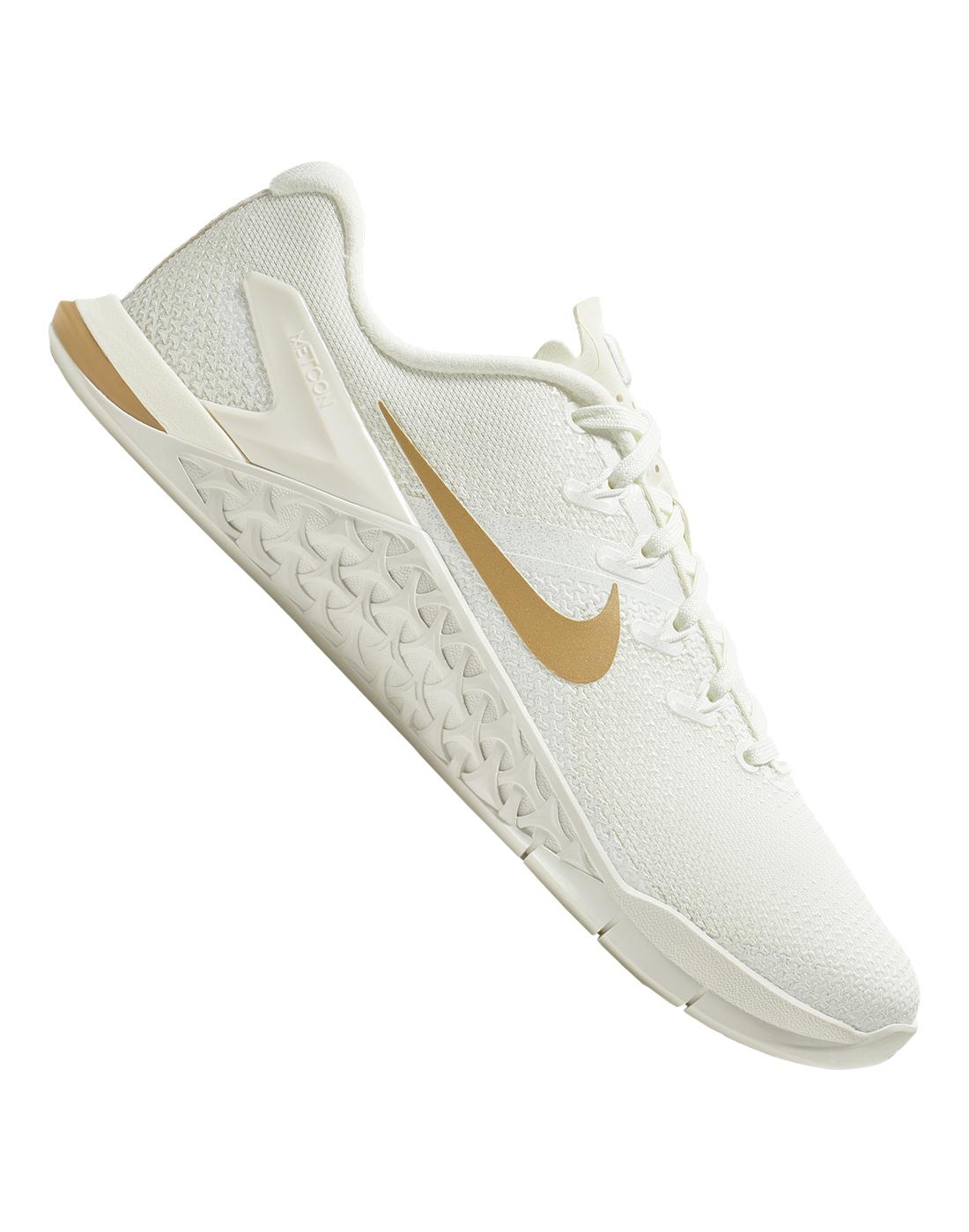 b25ae34775029 Women s White   Gold Nike Metcon Gym Shoes